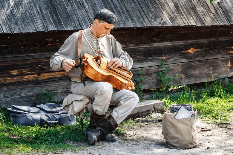 ukrainian street performer playing hurdy gurdy