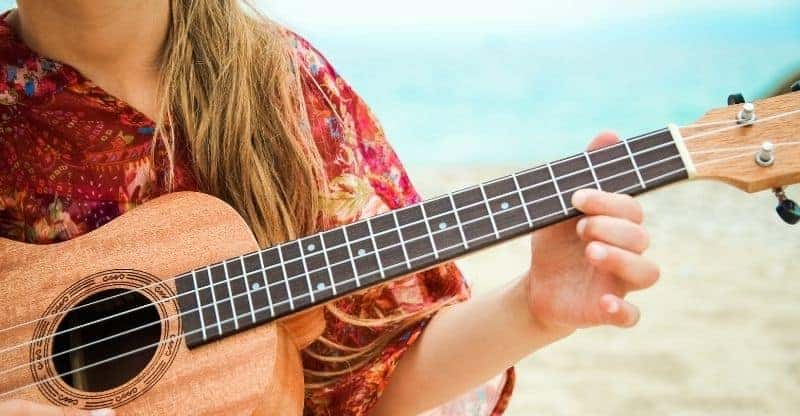 Girl playing a baritone ukulele