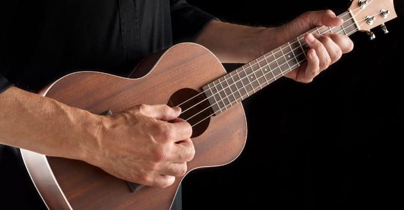 Man playing tenor ukulele