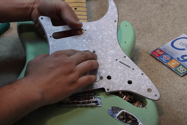 Removing stratocaster pickguard to access electronics