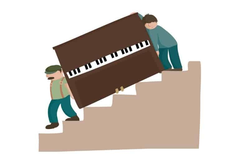Two guys moving piano down stairs