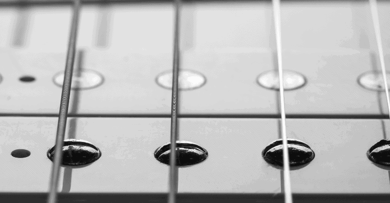 close up of a guitar pickup