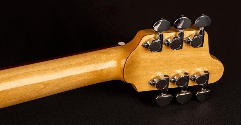 close up of a guitar volute