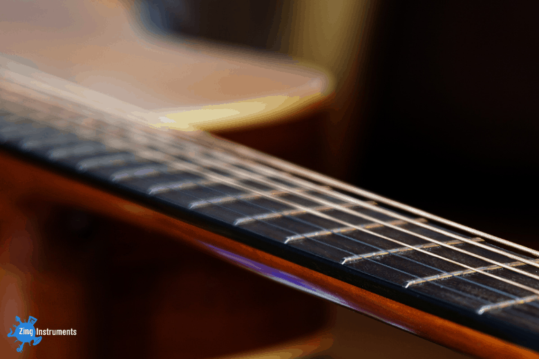 close up of acoustic guitar frets