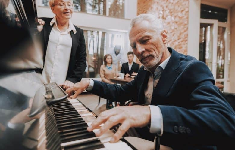 elderly man playing piano