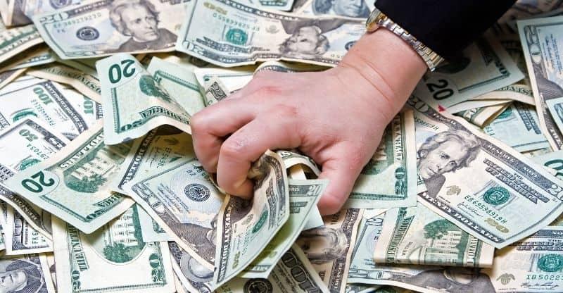 greedy hand grabbing money