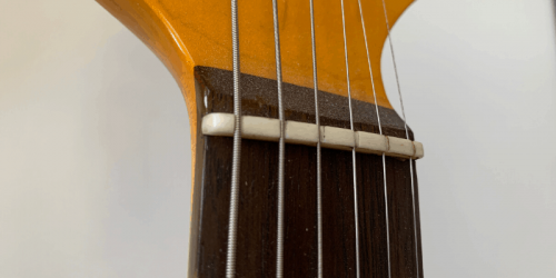 5 Main Types of Guitar Nuts – Main Differences Including Materials Used