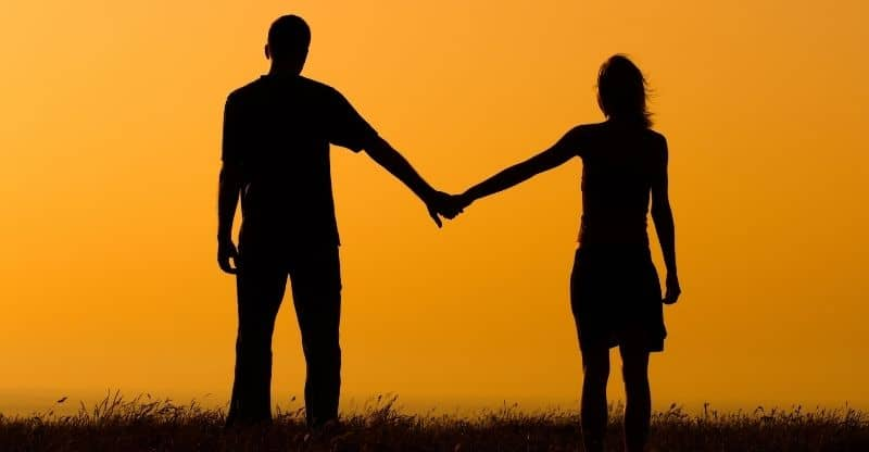 guy and woman holding hands