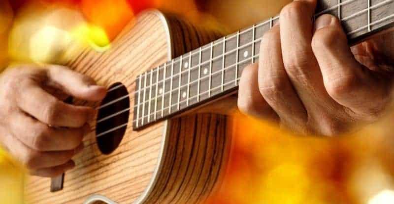 guy fingerpicking a ukulele