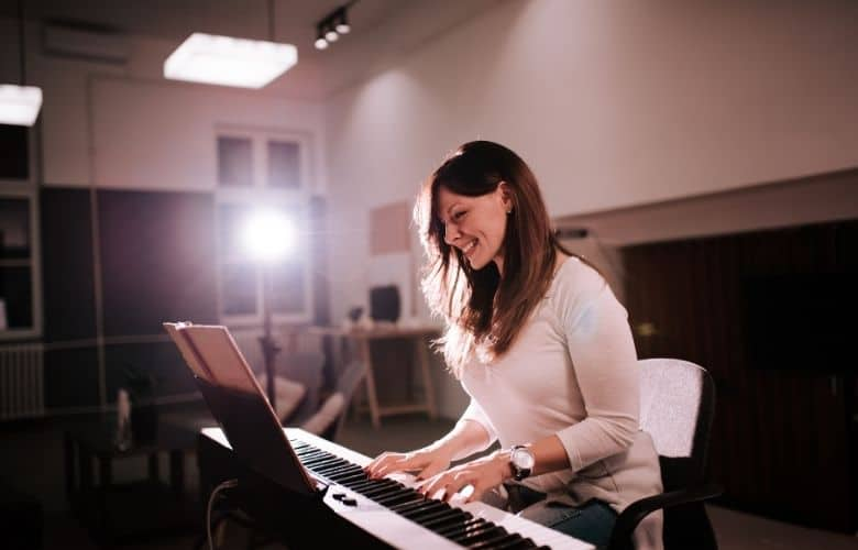 happy woman playing piano