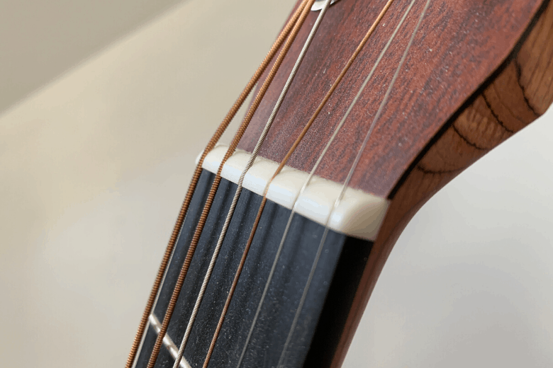 martin acoustic guitar nut close up