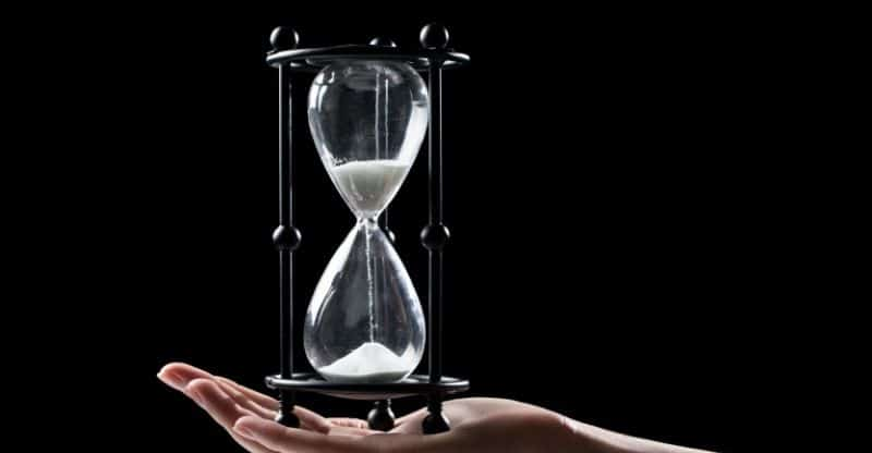 person holding an hourglass