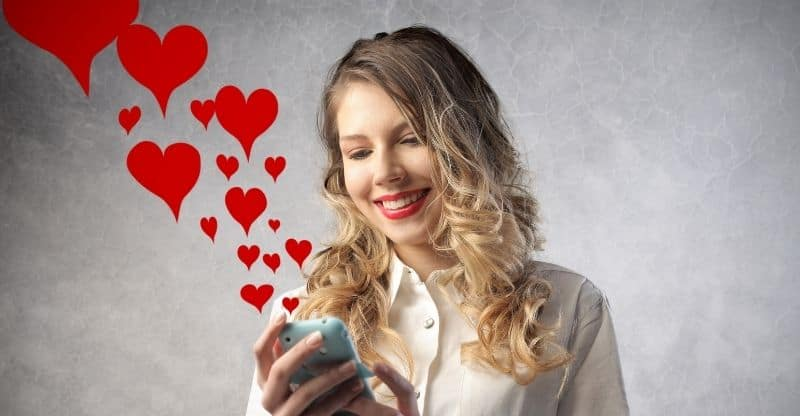 woman texting on phone with love hearts